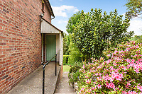 BNPS.co.uk (01202 558833)<br /> Pic: Homesestateagency/BNPS<br /> <br /> Pictured: The side of the property.<br /> <br /> A timewarp home that has been lived in by the same family for more than a century has gone on sale for the first time since being built.<br /> <br /> At the time the property was built, King Edward VII was on the throne and the First World War had not even started.<br /> <br /> The property is being sold for £550,000 under probate by the original builder's three grandchildren, who were born in the Victorian-style house.<br /> <br /> The two-bedroomed home is in the Surrey town of Haslemere and belonged to the Berry family, who decided to sell after the death of their parents, Freda and Leslie.
