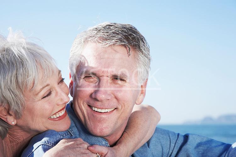USA, California, Fairfax, Happy mature couple sitting on beach