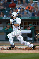 Drew Ober (18) of the Charlotte 49ers follows through on his swing against the Clemson Tigers at BB&T BallPark on March 26, 2019 in Charlotte, North Carolina. The Tigers defeated the 49ers 8-5. (Brian Westerholt/Four Seam Images)