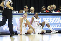 BERKELEY, CA - MARCH 30: Jayne Appel and Nneka Ogwumike wait at the scorer's table to get back into the game during Stanford's 84-66 win against the Ohio State Buckeyes on March 28, 2009 at Haas Pavilion in Berkeley, California.