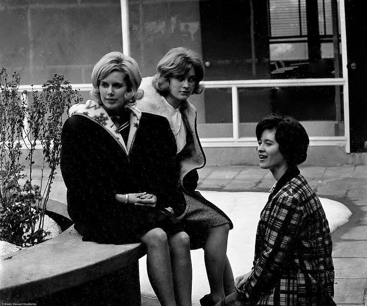 Bethel Park Senior High School:  View of students sitting in building 1's courtyard before their next class.  Students include; Cathy Stewart, Janet Watson, and Leslie Staub. The new Bethel Senior High School was dedicated on October 23, 1960, but the campus would not grow to its current size until seven years later. Phase II of the construction was completed in 1964 with the addition of another academic building and the industrial arts building. Phase III was completed in 1967 with the construction of the fourth academic building and a 6,300 seat football stadium and track, three tennis courts, seven basketball courts, and a baseball field.