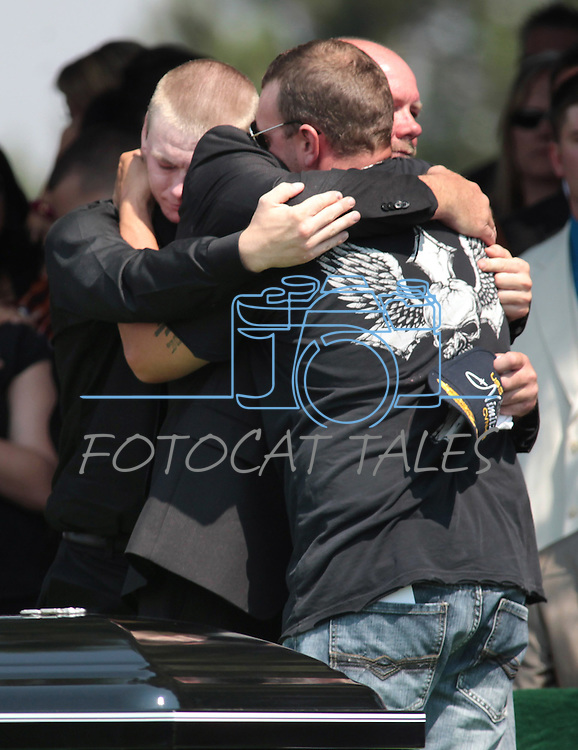 Family members of Colorado shooting victim Jonathan Blunk attended a memorial service in Reno, Nev. on Friday morning, Aug. 3, 2012. From left are, Blunk's brother Dillon Blunk, father Randy Blunk, and friend Nathan Trudeau. (AP Photo/Cathleen Allison)