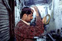 A man after cutting his hair at a barber shop at the Kashmiri bazaar in the old town of Lahore.<br /> 18.2.2001, Lahore/Pakistan<br /> Copyright: Christian-Ditsch.de<br /> [Inhaltsveraendernde Manipulation des Fotos nur nach ausdruecklicher Genehmigung des Fotografen. Vereinbarungen ueber Abtretung von Persoenlichkeitsrechten/Model Release der abgebildeten Person/Personen liegen nicht vor. NO MODEL RELEASE! Nur fuer Redaktionelle Zwecke. Don't publish without copyright Christian-Ditsch.de, Veroeffentlichung nur mit Fotografennennung, sowie gegen Honorar, MwSt. und Beleg. Konto: I N G - D i B a, IBAN DE58500105175400192269, BIC INGDDEFFXXX, Kontakt: post@christian-ditsch.de<br /> Bei der Bearbeitung der Dateiinformationen darf die Urheberkennzeichnung in den EXIF- und  IPTC-Daten nicht entfernt werden, diese sind in digitalen Medien nach §95c UrhG rechtlich geschuetzt. Der Urhebervermerk wird gemaess §13 UrhG verlangt.]