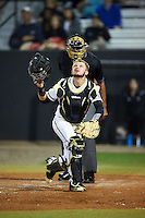 UCF Knights catcher Logan Heiser (1) looks for a popup in front of umpire Damien Beal during a game against the Siena Saints on February 17, 2017 at UCF Baseball Complex in Orlando, Florida.  UCF defeated Siena 17-6.  (Mike Janes/Four Seam Images)