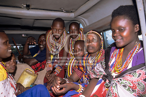 Lolgorian, Kenya. Local transport; Maasai family in a minibus on their way to the Eunoto coming of age ceremony.