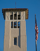 Church tower and American Flag in Beverly Hills with deep blue sky