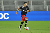 WASHINGTON, DC - JULY 7: Allexon Saravia #51 of D.C. United moves the ball during a game between Liga Deportiva Alajuense  and D.C. United at Audi Field on July 7, 2021 in Washington, DC.