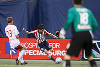 New York Red Bulls goalkeeper Jon Conway (18) watches as CD Chivas USA midfielder Jorge Flores (19) prepares to cross the ball in front of New York Red Bulls midfielder Chris Leitch (33). The New York Red Bulls defeated CD Chivas USA 1-0 during a Major League Soccer match at Giants Stadium in East Rutherford, NJ, on June 5, 2008.