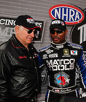 Nov. 13, 2011; Pomona, CA, USA; NHRA top fuel dragster driver Antron Brown (right) and former driver Don Garlits during the Auto Club Finals at Auto Club Raceway at Pomona. Mandatory Credit: Mark J. Rebilas-.