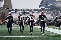 FOXBOROUGH, MA - OCTOBER 27: New England Patriots Runningback Sony Michel #26, New England Patriots Wide Receiver Julian Edelman #11, New England Patriots Runningback Rex Burkhead #34, New England Patriots Safety Patrick Chung #23 player's entrance to on a rain-drenched afternoon during a game between Cleveland Browns and New Enlgand Patriots at Gillettes on October 27, 2019 in Foxborough, Massachusetts.