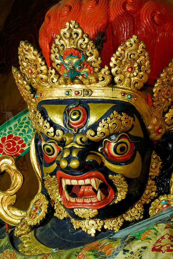 Three-eyed protector deity, Chana Dorje, or Vajrapani in Sanskrit, guards a chapel off the Main Assembly Hall, Drepung Monastery, Lhasa, Tibet, China..