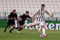 Cristiano Ronaldo of Juventus kicks a penalty scoring the goal of 1-1 during the Champions League round of 16 second leg football match between Juventus FC and Lyon at Juventus stadium in Turin (Italy), August 7th, 2020. <br /> Photo Federico Tardito / Insidefoto