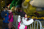 NEW YORK, NY – NOVEMBER 21: A family group takes a picture while a girl watches the balloons of the annual Macy's Thanksgiving Day parade the night before the parade on November 21, 2018 in New York City. (Photo by Pablo Monsalve /VIEWPress)