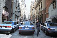 - Genoa, police cars in historical downtown....- Genova, auto della polizia in centro storico