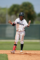 GCL Marlins Victor Mesa Jr. (9) motions to teammates after hitting a double off the fence during a Gulf Coast League game against the GCL Cardinals on August 12, 2019 at the Roger Dean Chevrolet Stadium Complex in Jupiter, Florida.  GCL Marlins defeated the GCL Cardinals 9-2.  (Mike Janes/Four Seam Images)