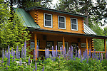 Bunkhouse and garage log cabin at Wildway, Moosehead Lake, ME.
