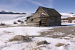 A historical homestead acreage and old log cabin take you back in time to the pioneers. A snowy Gallatin National Forest range in the backgound. Located by Bozeman Montana