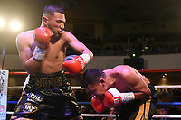 Youssef Khoumari (L) defeats Michael Isaac Carrero during a Boxing Show at the Dunstable Conference Centre on 7th March 2020