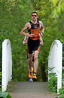 10 MAY 2015 - ST. NEOTS, GBR - Chris Standidge, racing in the men's 35-39 category, crosses a bridge during the 2015 British Sprint Triathlon Championships at Riverside Park in St. Neots, Great Britain (PHOTO COPYRIGHT © 2015 NIGEL FARROW, ALL RIGHTS RESERVED)