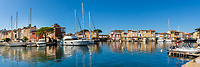 Port Grimaud lake city panorama with colorful houses, sailing boats and yachts reflecting in the blue sea, gulf of Saint-Tropez, Azure Coast France