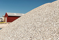 Mountain of broken oyster shells outside a packing shed in the fishing village of Port norris, New Jersey. The crushed shells are used to create paths and driveways.