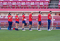 KASHIMA, JAPAN - AUGUST 5: Vlatko Andonovski and the USWNT staff stand for the national anthem before a game between Australia and USWNT at Kashima Soccer Stadium on August 5, 2021 in Kashima, Japan.