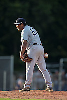 Pulaski Yankees starting pitcher Juan Jimenez (67) looks to his catcher for the sign against the Danville Braves at American Legion Post 325 Field on July 31, 2016 in Danville, Virginia.  The Yankees defeated the Braves 8-3.  (Brian Westerholt/Four Seam Images)