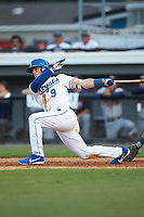Jake Means (9) of the Burlington Royals follows through on his swing against the Danville Braves at Burlington Athletic Stadium on July 13, 2019 in Burlington, North Carolina. The Royals defeated the Braves 5-2. (Brian Westerholt/Four Seam Images)