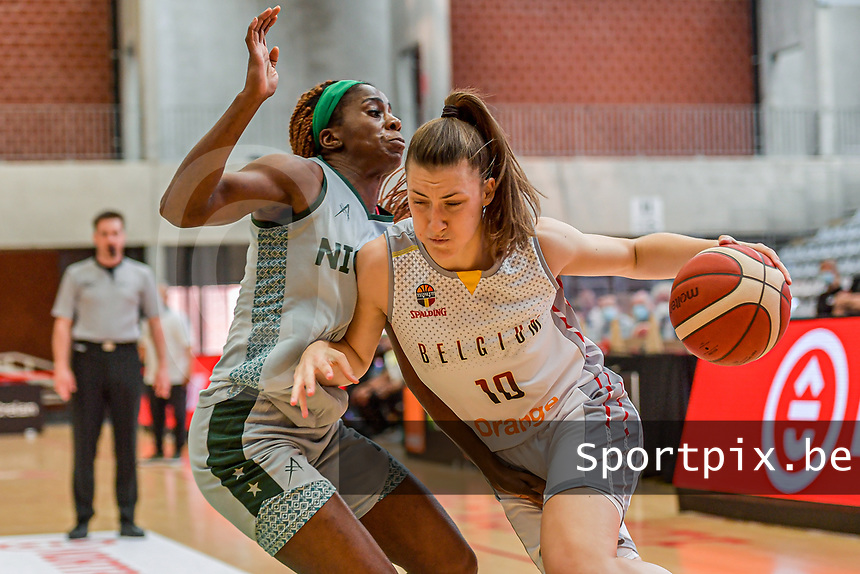 Laure Resimont (10) of Belgium and Sarah Ogoke (7) of Nigeria pictured during a basketball game between the national teams of Belgium , called the Belgian Cats , and Nigeria on Sunday 30 th of May 2021 in Kortrijk , Belgium . PHOTO SPORTPIX.BE | SPP | STIJN AUDOOREN