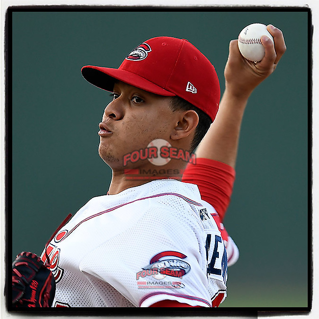 Starting pitcher Hildemaro Requena (20) of the Greenville Drive delivers a pitch in Game 3 of the South Atlantic League Southern Division Playoff against the Charleston RiverDogs on Saturday, September 9, 2017, at Fluor Field at the West End in Greenville, South Carolina. Greenville won, 5-0, winning the division championship two games to one. (Tom Priddy/Four Seam Images)