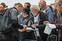 Graeme Jones (Manager) of Luton Town signs autographs on arriving for the Sky Bet Championship match between Derby County and Luton Town at the Ipro Stadium, Derby, England on 5 October 2019. Photo by David Horn.
