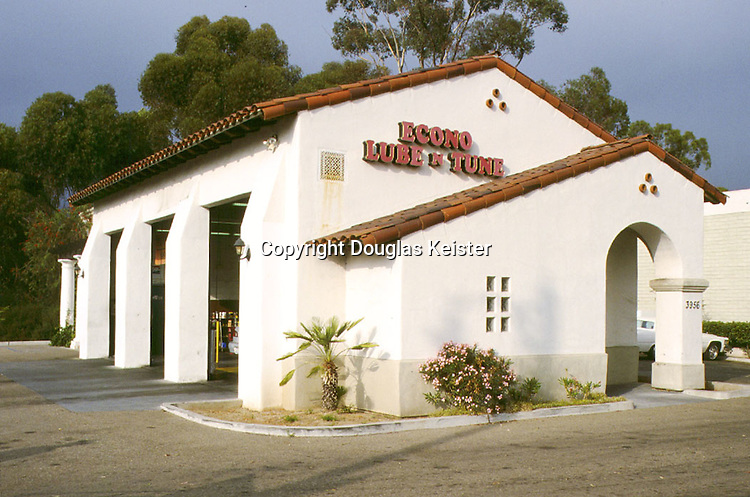 The walls of this repair garage features a carefully-studied arrangement of solids and voids, along with authentic detailing such as the powerful arch, barrel-tiled gable edge, and clusters of clay pipe vents.  Located in Santa Barbara, its design is the result of an unusually restrictive design ordinance that essentially mandates Spanish Revival as the city's official style--a draconian policy that, while certainly open to criticism, has nevertheless placed the city at the forefront of quality and diversity in modern Spanish Revival work.