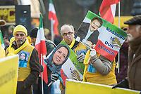"""Mehrere hundert Exil-Iraner demonstrierten am Samstag den 23. November 2019 in Berlin gegen die Regierung in Teheran. Sie solidarisierten sich mit den Aufstaendischen, die seit mehreren Wochen gegen das Regime protestieren. Mehr als 250 Menschen sollen bei den Protesten mittlerweile von den sog. """"Revolutionsgarden"""" erschossen worden sein.<br /> Aufgerufen zu der Demonstration vor dem Brandenburger Tor hatte die Gruppe """"Nationaler Widerstandsrat Iran"""" - NWRI.<br /> Im Bild: Einige Demonstranten trugen ein Portrait des NWRI-Mitbegruenders Massoud Rajavi und seiner Ehefrau Maryam Rajavi mit der Aufschrift """"Massud ist unser Anfuehrer"""".<br /> 23.11.2019, Berlin<br /> Copyright: Christian-Ditsch.de<br /> [Inhaltsveraendernde Manipulation des Fotos nur nach ausdruecklicher Genehmigung des Fotografen. Vereinbarungen ueber Abtretung von Persoenlichkeitsrechten/Model Release der abgebildeten Person/Personen liegen nicht vor. NO MODEL RELEASE! Nur fuer Redaktionelle Zwecke. Don't publish without copyright Christian-Ditsch.de, Veroeffentlichung nur mit Fotografennennung, sowie gegen Honorar, MwSt. und Beleg. Konto: I N G - D i B a, IBAN DE58500105175400192269, BIC INGDDEFFXXX, Kontakt: post@christian-ditsch.de<br /> Bei der Bearbeitung der Dateiinformationen darf die Urheberkennzeichnung in den EXIF- und  IPTC-Daten nicht entfernt werden, diese sind in digitalen Medien nach §95c UrhG rechtlich geschuetzt. Der Urhebervermerk wird gemaess §13 UrhG verlangt.]"""
