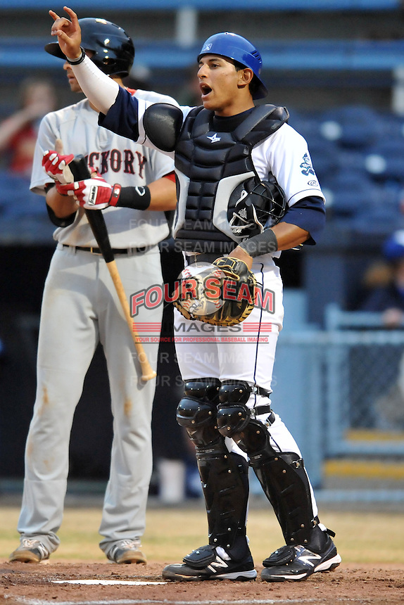 Asheville Tourists catcher Jose Briceno #4 during a game against the Hickory Crawdads at McCormick Field on April 15, 2013 in Asheville, North Carolina. The Crawdads won the game 6-3. (Tony Farlow/Four Seam Images via AP Images).