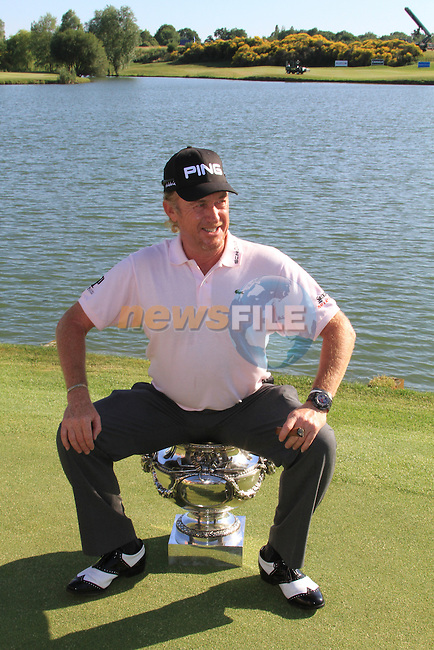 Miguel Angel Jiménez winner of the Alstom Open de France at .Golf National St Quentin en Yvelines, Paris France, 4/7/10. `After playing a sudden death with Francesco Molinari and Alejandro Canizares Jimenez sunk the put on the 18th green to win..Picture Fran Caffrey/www.golffile.ie