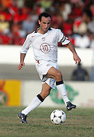 09 February, 2005.USMNT captain Landon Donovan brings the ball forward during the World Cup qualifier at Queen's Park Oval in Port of Spain, Trinidad and Tobago.  The USMNT defended Trinidad and Tobago 2-1.