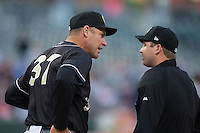 Charlotte Knights manager Joel Skinner (37) argues a call with home plate umpire Matt McCoy during the game against the Toledo Mud Hens at BB&T BallPark on April 27, 2015 in Charlotte, North Carolina.  The Knights defeated the Mud Hens 7-6 in 10 innings.   (Brian Westerholt/Four Seam Images)