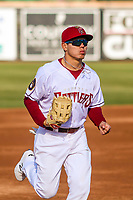 Wisconsin Timber Rattlers outfielder Jesus Lujano (7) jogs to the dugout between innings during a Midwest League game against the Burlington Bees on April 26, 2019 at Fox Cities Stadium in Appleton, Wisconsin. Wisconsin defeated Burlington 2-0. (Brad Krause/Four Seam Images)