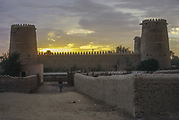 Al Ain, UAE, March 1972. Silhouette of Al Ain Fort at Sunset.