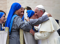 Papa Francesco saluta un gruppo di suore al termine dell'udienza generale del mercoledi' in Piazza San Pietro, Citta' del Vaticano, 10 settembre 2014.<br /> Pope Francis greets some nuns at the end of his weekly general audience in St. Peter's Square at the Vatican, 10 September 2014.<br /> UPDATE IMAGES PRESS/Isabella Bonotto<br /> <br /> STRICTLY ONLY FOR EDITORIAL USE