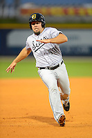 Jacksonville Suns third baseman Zack Cox #40 slides into third during a game against the Pensacola Blue Wahoos on April 15, 2013 at Pensacola Bayfront Stadium in Pensacola, Florida.  Jacksonville defeated Pensacola 1-0 in 11 innings.  (Mike Janes/Four Seam Images)