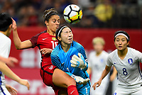 New Orleans, LA - Thursday October 19, 2017: Carli Lloyd, Kang Gaae during an International friendly match between the Women's National teams of the United States (USA) and South Korea (KOR) at Mercedes Benz Superdome.