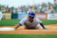 New York Mets shortstop Ruben Tejada #11 dives back to first on a pickoff attempt during a Spring Training game against the Detroit Tigers at Joker Marchant Stadium on March 11, 2013 in Lakeland, Florida.  New York defeated Detroit 11-0.  (Mike Janes/Four Seam Images)