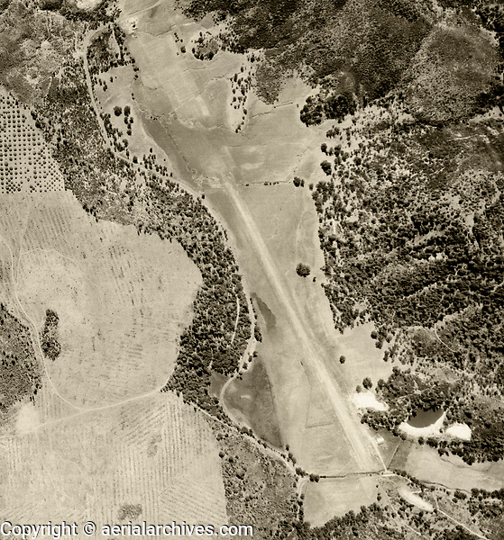 historical aerial photograph of Paul Hoberg airport (Q79), Loch Lomond near Middletown, Lake County, California, 1956