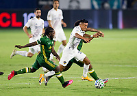 CARSON, CA - OCTOBER 07: Yimmi Chara #23 of the Portland Timbers gets after Julian Araujo #22 of the Los Angeles Galaxyl during a game between Portland Timbers and Los Angeles Galaxy at Dignity Heath Sports Park on October 07, 2020 in Carson, California.