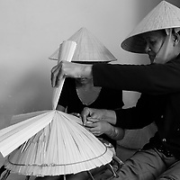 old woman teach grand-daughter how to make traditional hat, <br /> Nha Trang, Vietnam