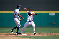 Detroit Tigers second baseman Andre Lipcius (41) throws to first base as shortstop Carlos Irigoyen (43) backs up the play during a Florida Instructional League intrasquad game on October 17, 2020 at Joker Marchant Stadium in Lakeland, Florida.  (Mike Janes/Four Seam Images)