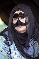 Oman.  Woman Wearing a Burqa (Face Mask).