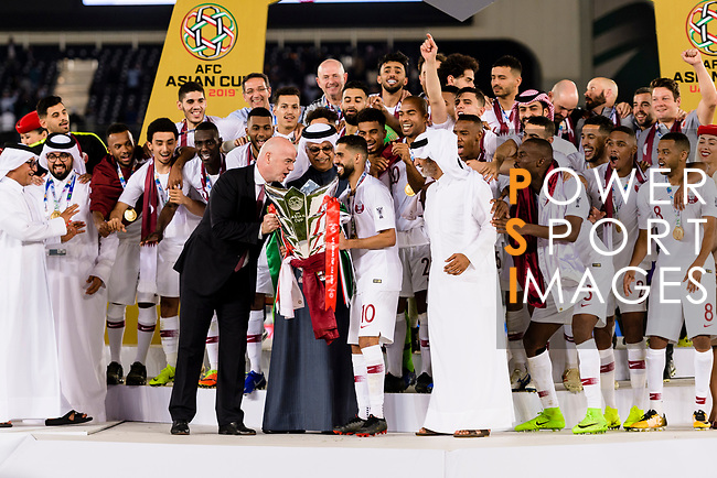 FIFA president Gianni Infantino (L) gives the Asian Cup trophy for Hasan Al Haydos of Qatar (R) during the AFC Asian Cup UAE 2019 Final match between Japan (JPN) and Qatar (QAT) at Zayed Sports City Stadium  on 01 February 2019 in Abu Dhabi, United Arab Emirates. Photo by Marcio Rodrigo Machado / Power Sport Images