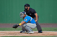 Myrtle Beach Pelicans catcher Miguel Amaya (9) and umpire Josh Gilreath during a Carolina League game against the Potomac Nationals on August 14, 2019 at Northwest Federal Field at Pfitzner Stadium in Woodbridge, Virginia.  Potomac defeated Myrtle Beach 7-0.  (Mike Janes/Four Seam Images)